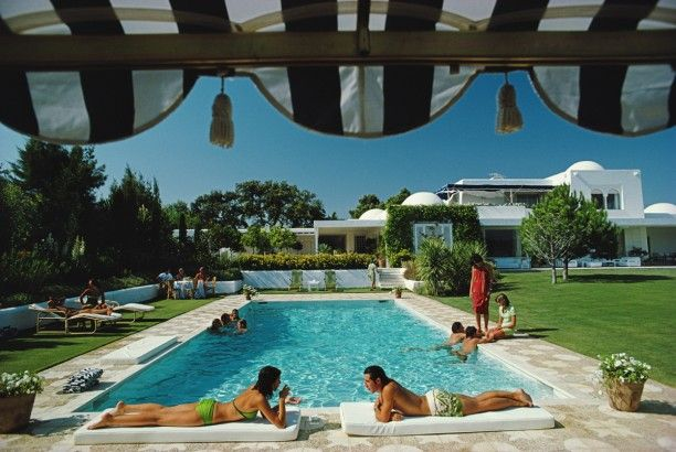 'Pool In Sotogrande'  Open Edition or Limited Edition Estate Stamped Ctyp Print (edition size 1/150).  Bathers round a pool in Sotogrande, Spain, August 1975. (Photo by Slim Aarons)  Available to order online in various sizes & frames at GALERIEPRINTS.com