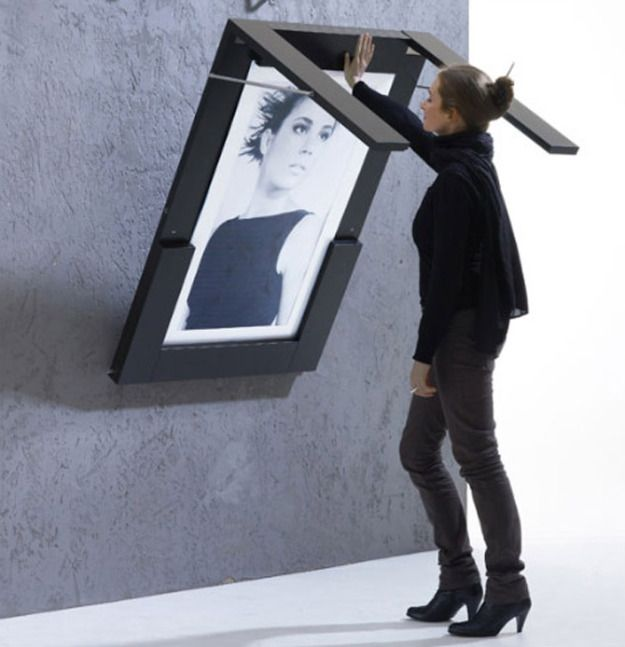Dual Purpose Furniture Table folds down from wall, where it is stored as ART!