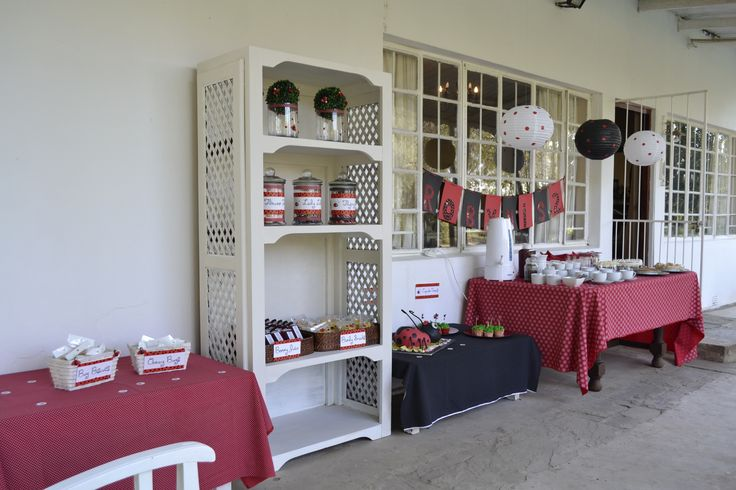 Red and white decor.. sweets themed in black and red and placed in glass bottles and baskets.