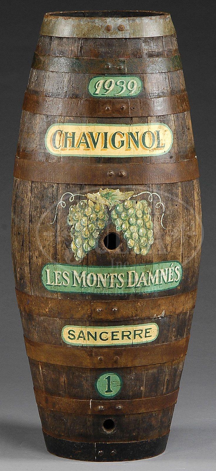 stacked oak barrels maturing red wine. oak iron bound wine barrel. stacked oak barrels maturing red wine