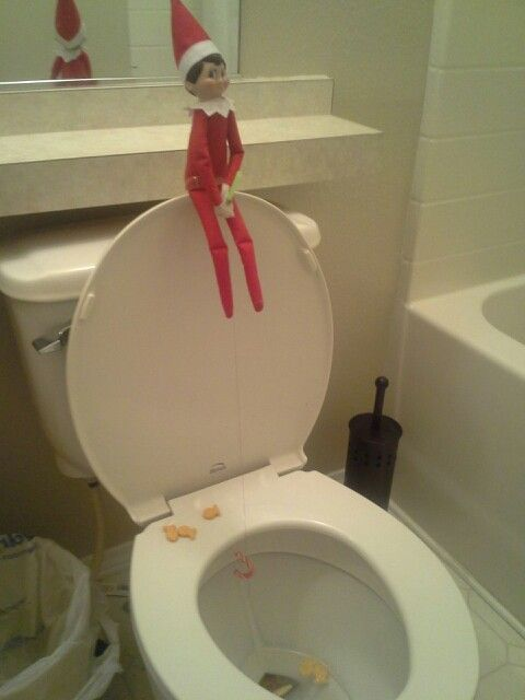 Elf goes fishing with a candy cane