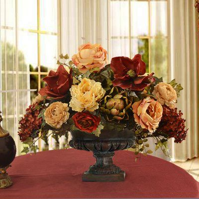 "Burgundy Magnolia and Peony Grande Silk Floral Centerpiece AR339-A - This elegant silk floral arrangement in deep contrasting color makes a statement with its grandee size. Created with quality magnolias, open roses, artichoke and cone hydrangeas. Measures 17"" H x 20"" W x 14""D"