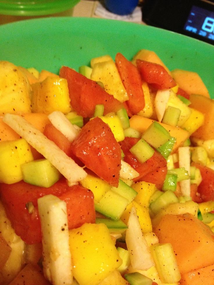 Mexican Fruit Salad-Jicima, Cucumber, Cantaloupe, Watermelon, Mango, Pineapple, Lime Juice (fresh), Chili and a little salt. Healthy and yummmmm