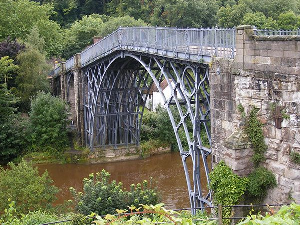The Iron Bridge, England    The Iron Bridge crosses the River Severn at the Ironbridge Gorge by the village of Ironbridge in Shropshire. It was the first arch bridge in the world to be made out of cast iron. The bridge was opened in 1781.