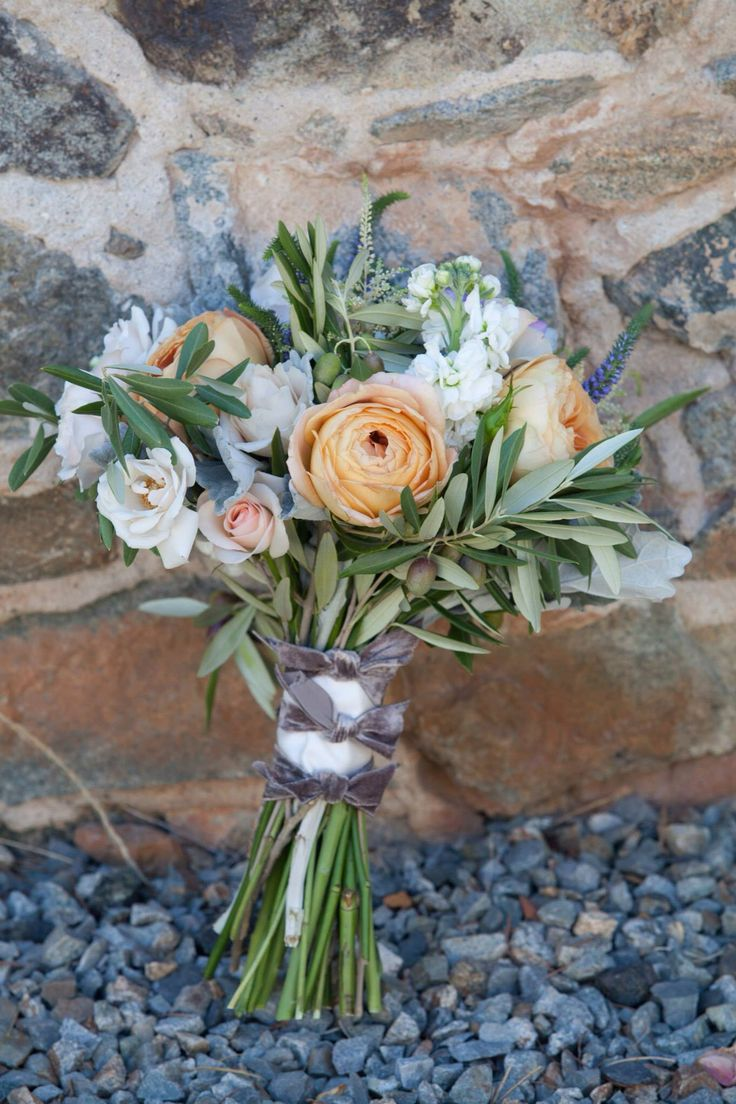 Deja: I like this but I would want my bouquet to have more draping. not circular Garden roses and olive branch Wedding Bouquet