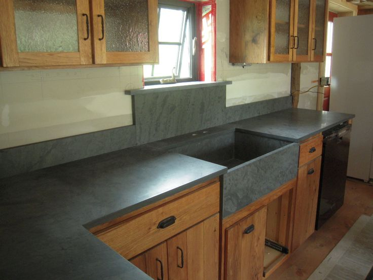 Marvelous Solid Slate Counter, Big Sink And Glass Front Doors