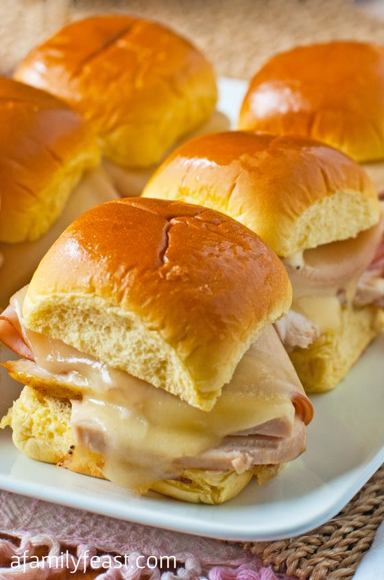 Chicken Cordon Bleu Sliders - a quick and delicious lunch! Tender chicken, ham and swiss cheese with a delicious honey-mayo poppy seed dressing. This is delicious!