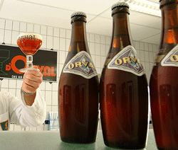 """Oval - Orval Trappist Brewery, Villers D'Orval, Belgium : A genuine Trappist beer in a unique bowling pin bottle, Orval """"starts off with a cascade of aromas"""", including malt, """"flowery hops"""" and the """"unique  Brettanomyces pungency"""". """"Gentle hops"""" blnds with tartness and a """"musty, malt cellar character"""" for taste. """"Immensely refreshing"""". A Must-Try beer"""