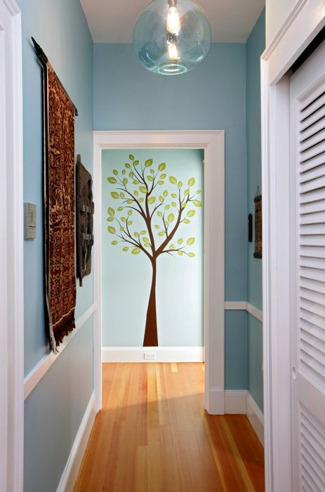 Love the way the tree (decal?) is framed by the door. Great idea for Narrow Hallway Leading to the Kids playroom!