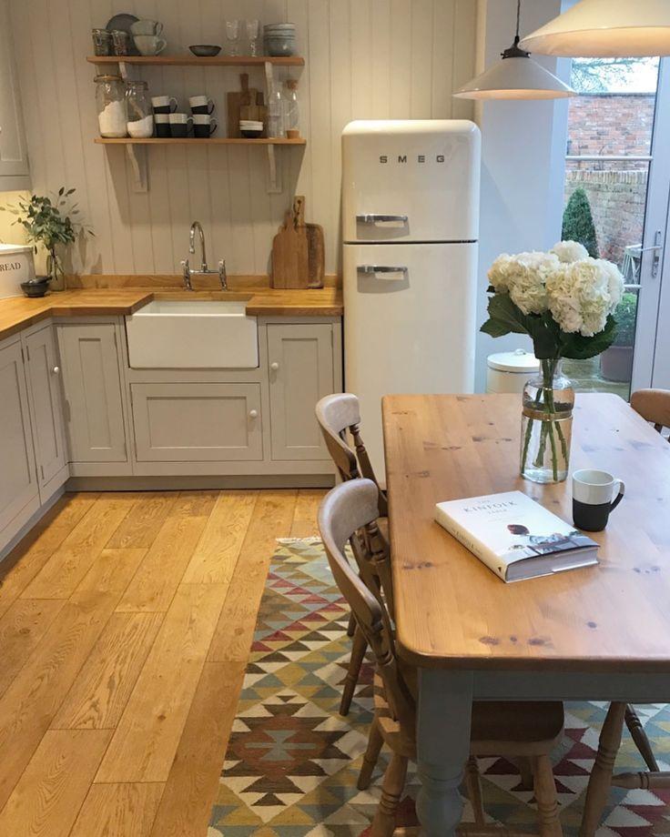 Adorable refrigerator, butcher block counter, open shelving and hardwood floors.