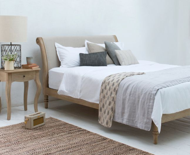 Our Darcy bed is a contemporary take on an antique French bed. It's dashing, elegant and hand carved in weathered oak making it lip-smackingly lovely!