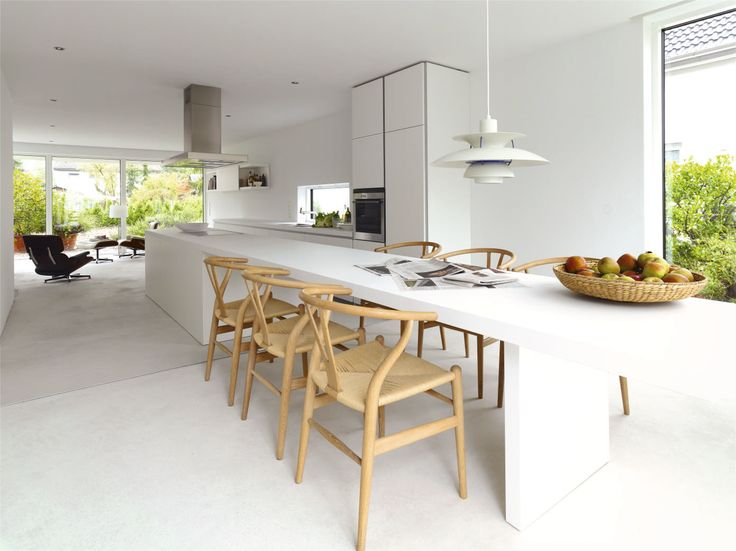 Bulthaup Kitchen Island Part - 19: Bulthaup Kitchen Island In White Has Been Extended Into A Table That Seats  Wishbone Chairs Designed By Hans J. Wegner And Produced By Carl Hansen U0026  Son ...
