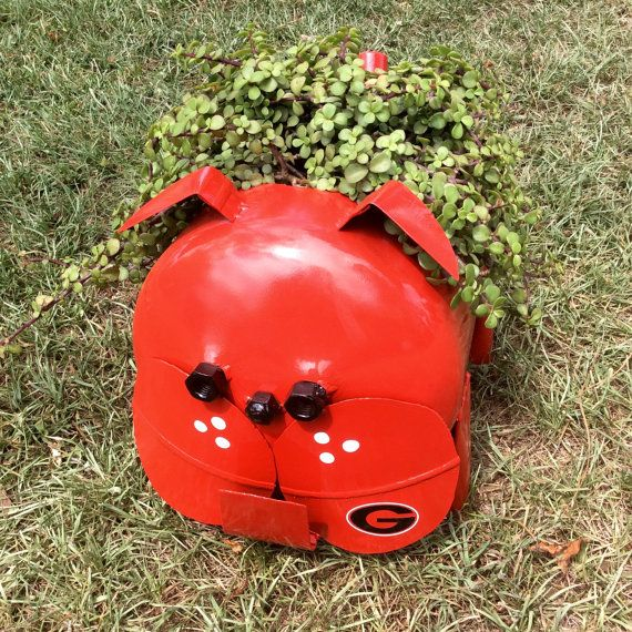 Georgia Bulldog Planter Painted Sculpture  GO DAWGS! Made from an old and empty freon (gas) cylinder and steel pipe for the legs. Painted with RUST RESISTANT paint to give it the best look and durability. Includes a black G decal placed on front cheek.  This variation has a hole cut in, using a plasma cutter, for a 6-8 flower pot and holes in the bottom for drainage. Makes a GREAT gift for someone special!  Approximate Size: High: 12 Wide: 10 Deep: 15  SHIPS IMMEDIATELY   Be sure to favorite…