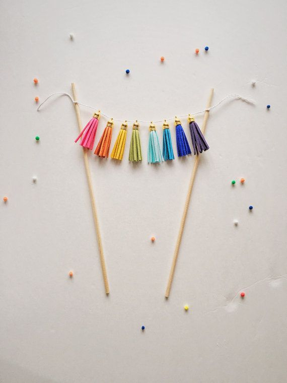 This fun and bright tassel cake topper will accent any birthday cake and make it color pop!  This item can be made with custom text as well.