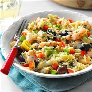 Mediterranean Shrimp Orzo Salad Recipe -This pretty crowd-pleaser always stands out on the buffet table. With plenty of shrimp, artichoke hearts, olives, peppers and a host of herbs, it's a tasty change-of-pace from pasta salads. I serve it with a from-scratch vinaigrette.—Ginger Johnson, Pottstown, Pennsylvania