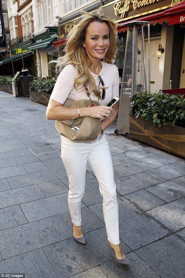 Effortless elegance: Strolling through the sunny streets of the capital, the 44-year-old B...