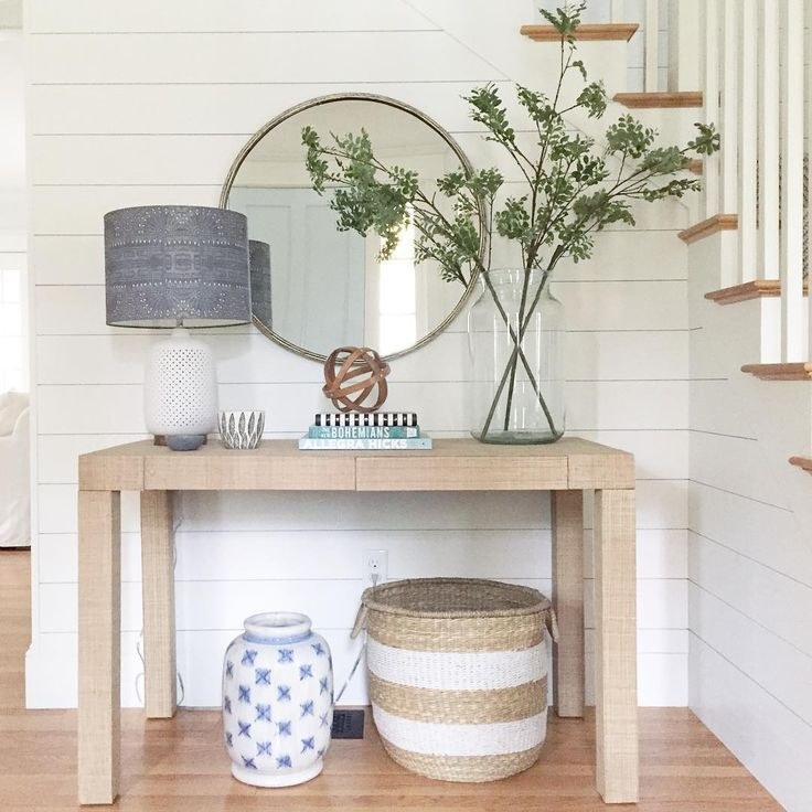 entry by meredith @viewfrommyheels Shiplap staircase with grasscloth console and brass round mirror.