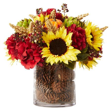Craft a charming centerpiece or lush vignette with this autumnal arrangement, featuring faux sunflowers and gourds nestled in a glass vase with artificial pi...
