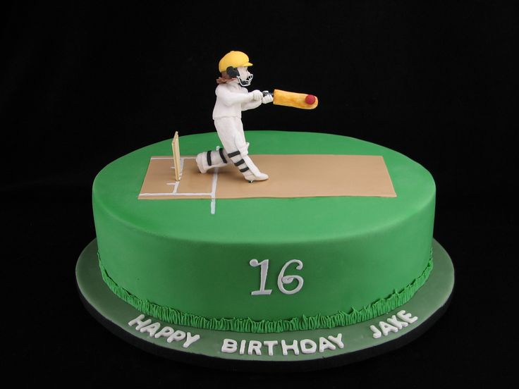 Cricket: Happy 16th birthday Jake! I hope you like my mini version of you on a cake :) This is a 14 inch long oval chocolate cake with chocolate frosting filling and covered in fondant.