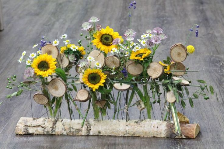 Great Vintage-Boho centerpiece of sunflowers for your wedding. Design by Blickfang Tropp Austria.