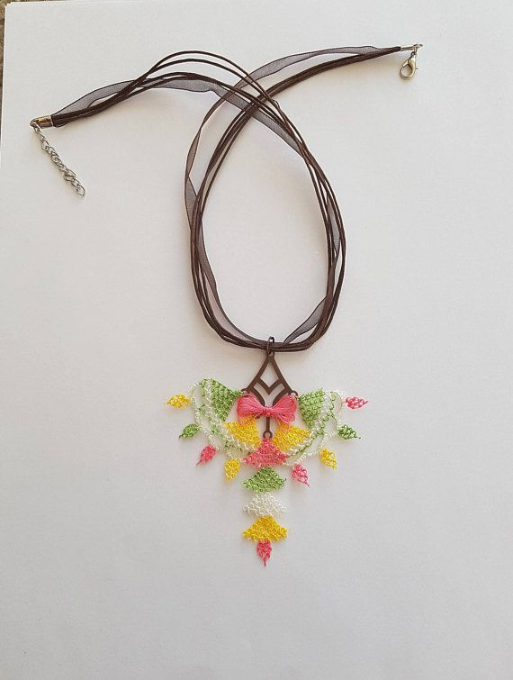 Needle lace necklace has really nice with the bow design.