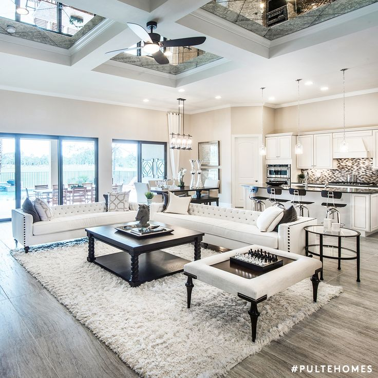 sophisticated living room. A bright  white living space that inspires rounds of conversation and games with family 126 best Sophisticated Living Rooms images on Pinterest Pulte