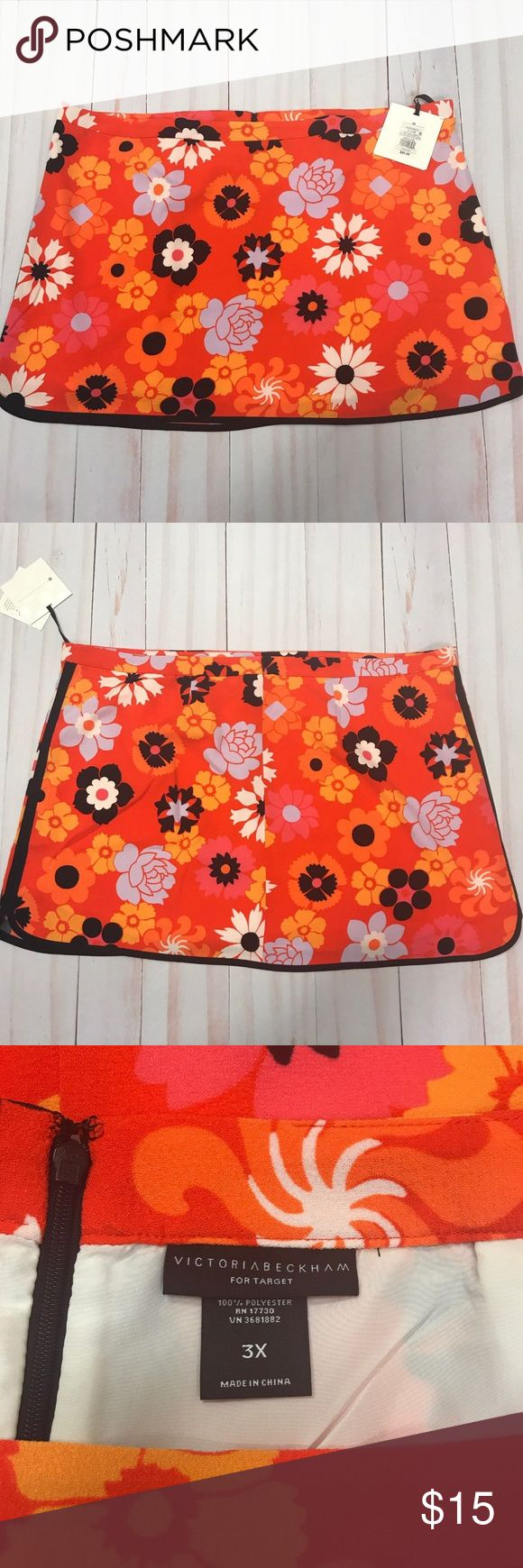 """Victoria Beckham For Target Plus Size Mini Skirt New with tags Victoria Beckham for Target women's 3X floral lined mini skirt.  The skirt measures flat across the waist 25.5"""" and is 19"""" .  Two small stains please look at last two photos. Victoria Beckham for Target Skirts Mini"""