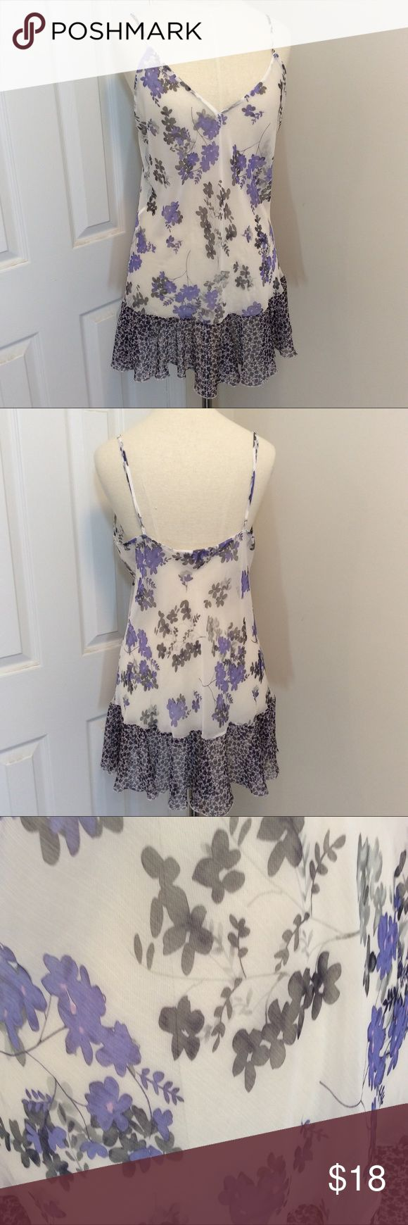 Victoria's Secret purple flowers baby doll size L Victoria's Secret purple flowers baby doll with adjustable straps size large. Sexy baby doll to wear on a honeymoon, anniversary or just that special night. Measurements taken from the back with garment laying flat bust is 34 inches and the length is 22 inches measured from under the arm. GUC questions??? Please ask Victoria's Secret Intimates & Sleepwear Pajamas