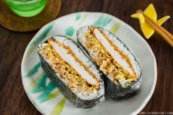 Delicious Chicken Katsu Onigirazu made with healthy baked chicken katsu, tonkatsu sauce, mustard, steamed rice, and thinly sliced cabbage.