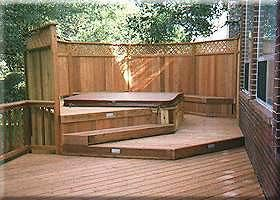 Love the privacy of this and flow of deck to hot tub.