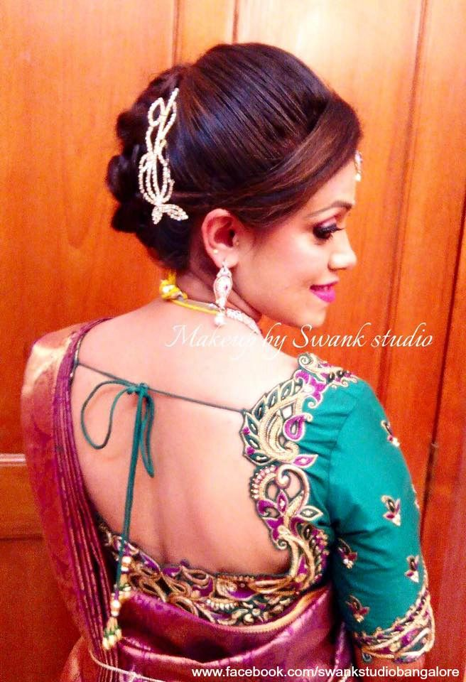 Indian bride's reception hairstyle by Swank Studio. Saree Blouse Design. Hair Accessory. Tamil bride. Telugu bride. Kannada bride. Hindu bride. Malayalee bride. Find us at https://www.facebook.com/SwankStudioBangalore