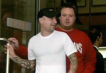 """Andrew """"Benji"""" Veniamin and Carl Williams leave Melbourne Magistrates Court together on the morning of Benji's last day alive, 23 March 2004."""