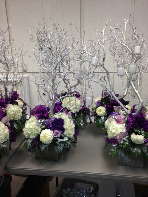 """A complete package of decor for a Glam and/or Winter Wonderland themed wedding. When the guests entered our venue on Dec. 21, 2013 they were amazed at how beautiful it looked- sparkling, glowing decor that all flowed together. Everything only used once and is in excellent condition. The package consists of: 13- 3' tall silver glitter/frosted manzanita trees in 6"""" silver cube vases; 169 clear garland gems (5"""" to 11"""" variety); 50 hanging glass votive holders; 71 bling votive candle holders…"""