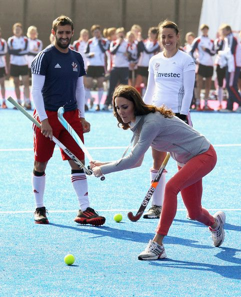 Women's Team GB hockey captain Kate Walsh and men's team player Niall Stott watches Catherine, Duchess of Cambridge play hockey with the GB hockey teams at the Riverside Arena in the Olympic Park on March 15, 2012 in London.