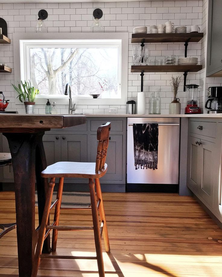 If I have to paint cabinets, I would choose to paint them this Chelsea Gray color from Benjamin Moore. Also love the subway tile backsplash and industrial shelving and lighting