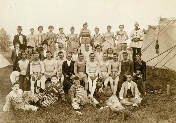 """""""Personnel of the Walter L. Main show in 1904 and 1905, photographed outside a tent, include clowns, the driver of a four horse chariot, and air performers. Their contemporary, circus man Frank B. Miller, described the group as 'A bunch of real old time actors, all damn good ones...'"""" (1905)"""