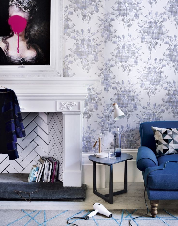 Modern living room with white fireplace and floral wallpaper