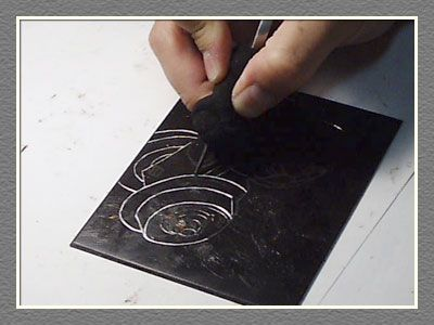 Etching is the process scratching indentations onto a surface to create a pattern that the ink would set into. Printing the plate is done by covering the surface with printing ink, then rubbing the ink off the surface with tarlatan cloth or newsprint, leaving ink in the roughened areas and lines.