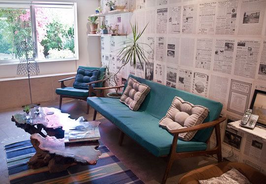 newspaper walls, and I love the mid century teal couch & chair