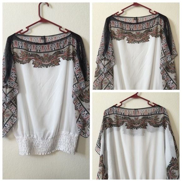 Floral white batwing top Gorgeous floral and white batwing top.  Barely worn. Maurices Tops Blouses