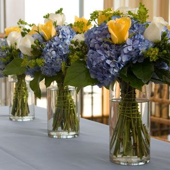 Use Dollar Tree Vases to create beauitful Floral Centerpieces.