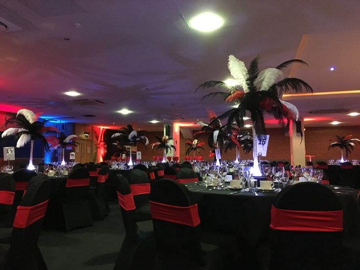 Red, black and white themed decor with LED feathered centrepieces