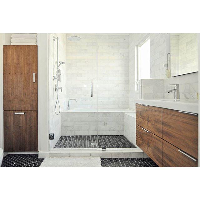 Simple, clean Flatsawn Walnut IKEA Godmorgon bathroom cabinet and matching linen closet by @bullockmcintyrestudio.
