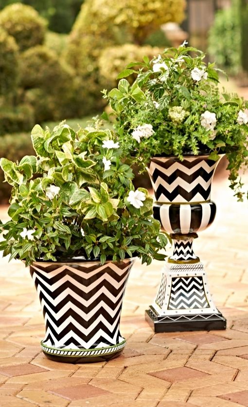 We've updated the classic Roman urn with a dynamic, hand-painted design and a finish that mimics glazed ceramic.