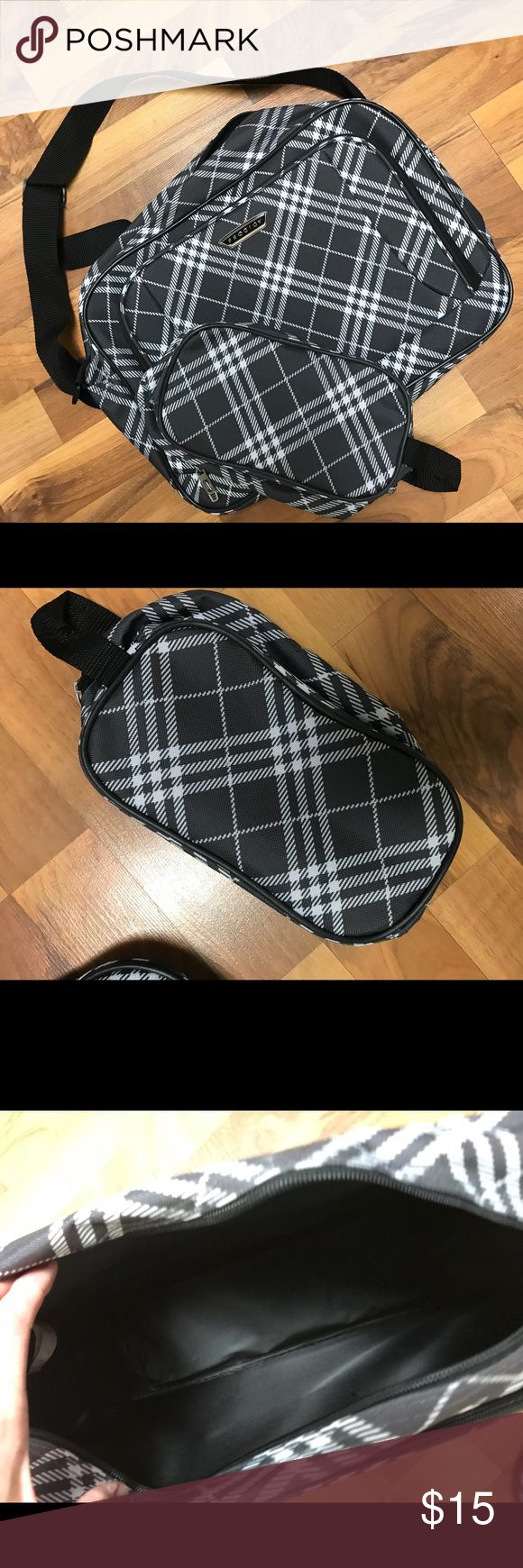 NWOT Prodigy 2 pc travel bag and toiletry bag This grey and black plaid 2 piece shoulder travel bag and toiletries bag is the perfect gift for any man or woman in your life. Brand new without tags. The slick material will resist water. prodigy Bags Luggage & Travel Bags