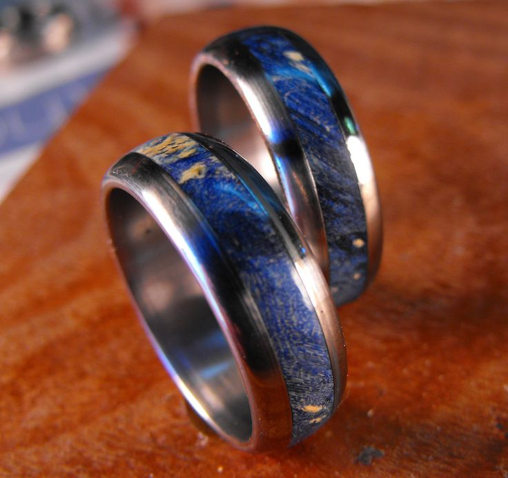 Titanium Wedding Band Set- Blue Box Elder Wood Inlay Rings. $265.00, via Etsy.  Kinda like tardis rings