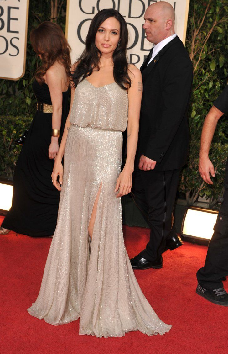 Pin for Later: Angelina Jolie's Wedding Dress Isn't Even Her Best Versace Look Angelina Jolie at the 2009 Golden Globe Awards The actress shimmered in this simple, ice-colored drop-waist gown by Atelier Versace.