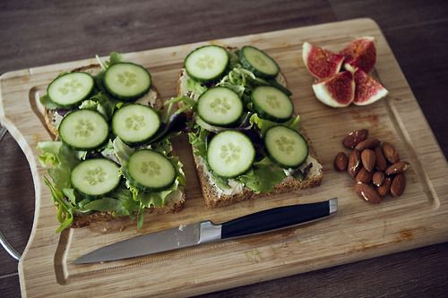 melanie-is-healthy:    Lunch open faced hummus salad cucumber sandwich with a yummy sliced fig and almonds
