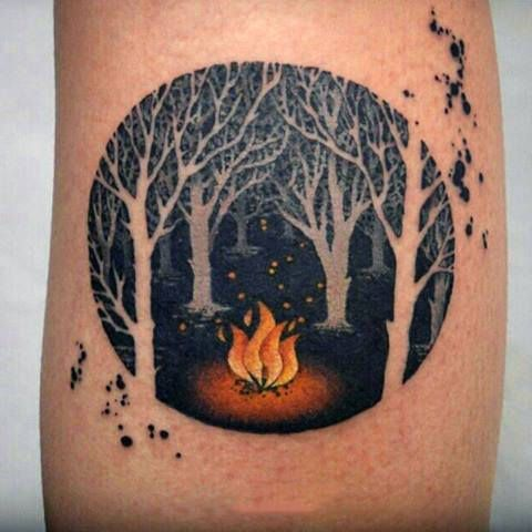Guy With Forearm Tattoo Fire In Forest At Night