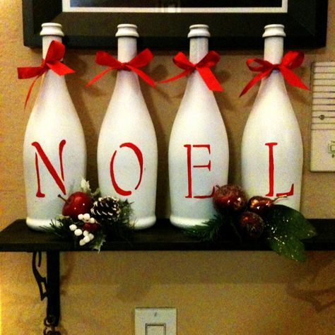 Repurposed wine bottles into Holiday decor. Supplies: assorted empty wine bottles, white matte spray paint, stencil, red acrylic craft paint, ribbon, paint brush. Instructions: remove any stickers from wine bottles, spray paint bottles in well ventilated area (2 coats), when bottles dry apply stencil with red craft paint and finish with a simple accent bow around the bottle neck. Happy Holidays